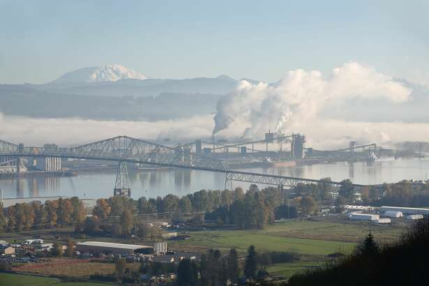 Longview, Washington State, USA. The Lewis and Clark Bridge crossing the Columbia River between Washington and Oregon. The top of Mount St. Helens in the background.