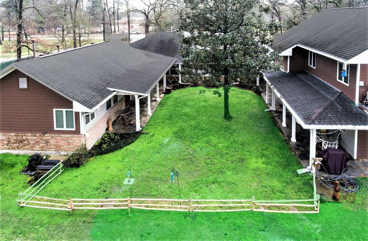 The view of the back of the home. The home sits on about 1.74acres.