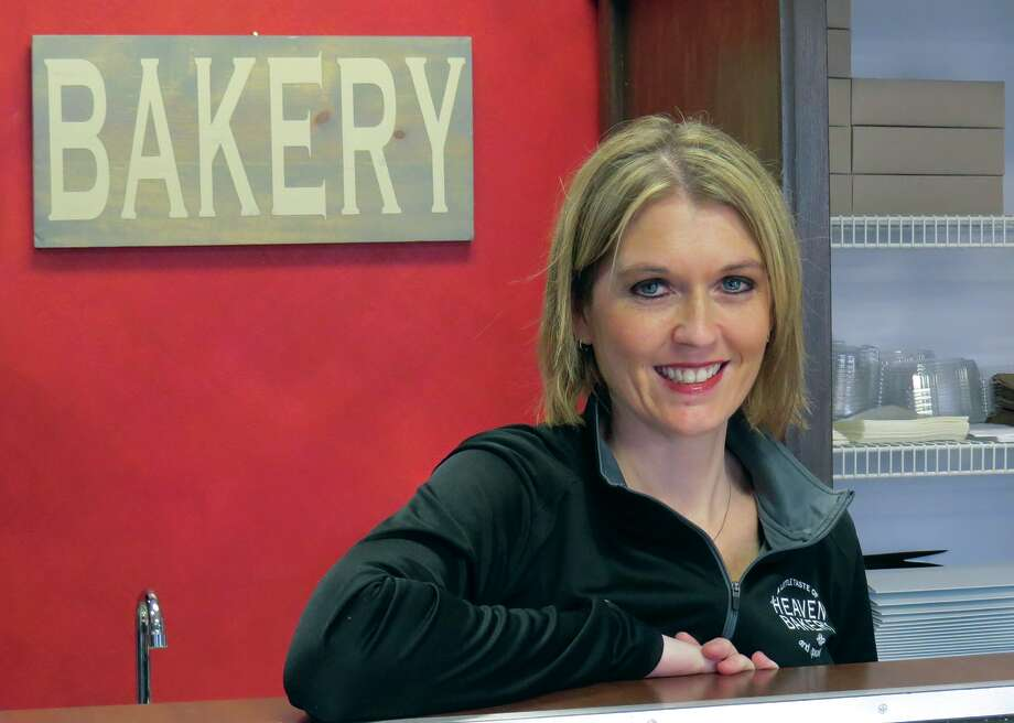 Lindsey Wulfing behind the counter at A Little
