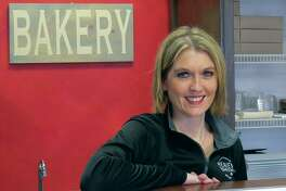 Lindsey Wulfing behind the counter at A Little Taste of Heaven. Wulfing is celebrating one year of owning the bakery.