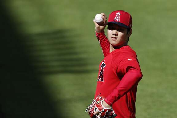Los Angeles Angels Shohei Ohtani (17) tosses the ball during batting practice before the start of an MLB game at Minute Maid Park, Monday, April 23, 2018, in Houston. He is scheduled to pitch tomorrow night. ( Karen Warren  / Houston Chronicle )