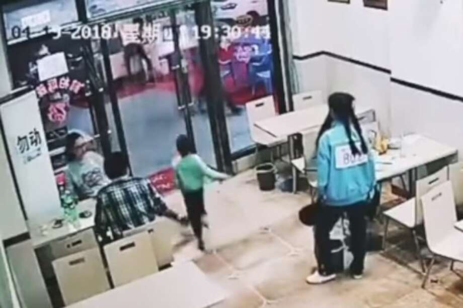 A pregnant woman tripped a four year old boy who inadvertently hit her in the face with a plastic curtains. Photo: YouTube