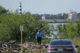 The Harris County Sheriff's Office Investigates the scene where a woman found dead near the boat ramp of Clear Lake Park Tuesday, April 24, 2018, in Seabrook, Texas.