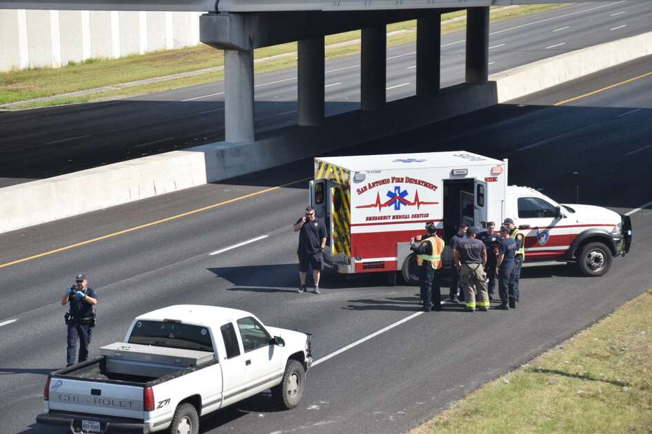 Police divert traffic off of I-35 North near the Loop 410 intersection after a fatal crash involving a pedestrian on April 24, 2018.