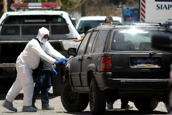 Experts from the Jalisco Institute of Forensic Sciences work at the scene where three film students went missing a month ago, at Haciendas de La Reina neighborhood in the municipality of Tonala, Guadalajara, Jalisco state, Mexico on April 19, 2018.