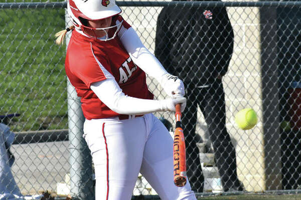 Alton's Rachel McCoy, shown driving the ball in a SWC loss against Edwardsville on April 5 at Alton High, came through with a two-run triple in the seventh inning Monday to tie the game before Belleville East answered with the winning runs in the bottom of the inning in Belleville.