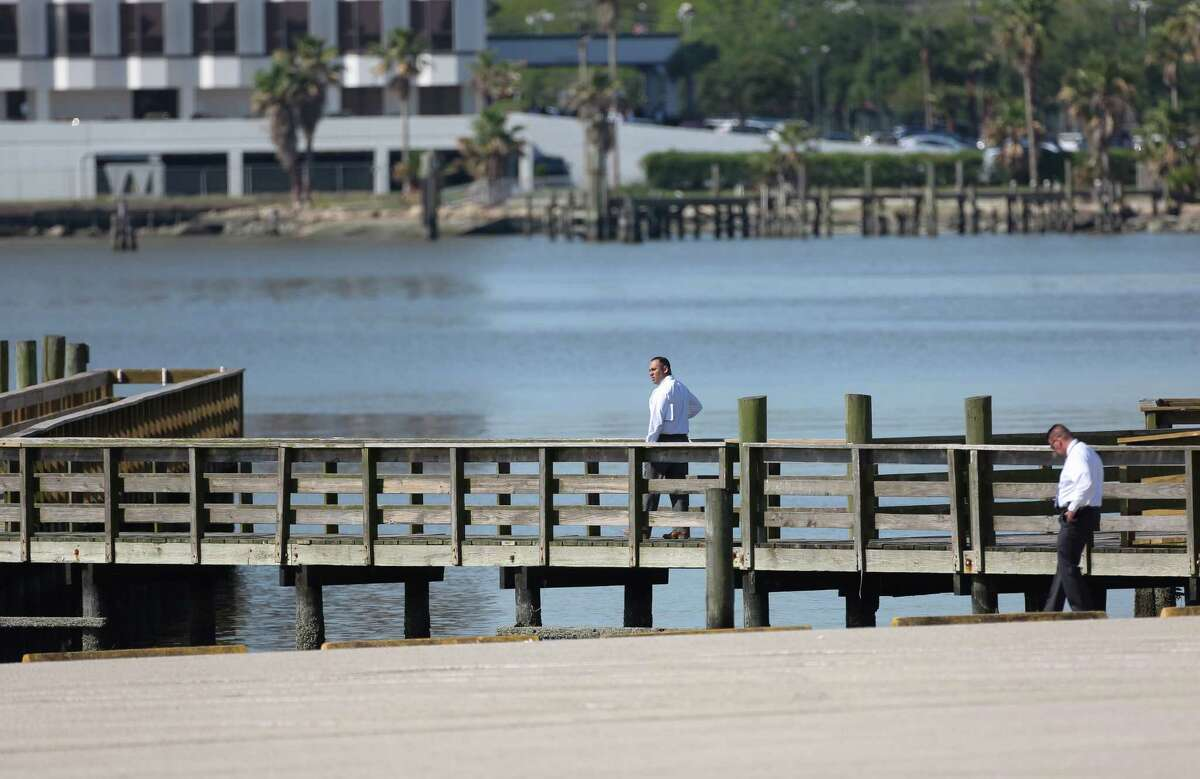 The Harris County Sheriff's Office homicide detectives Investigate the scene where a woman found dead near the boat ramp of Clear Lake Park Tuesday, April 24, 2018, in Seabrook, Texas.