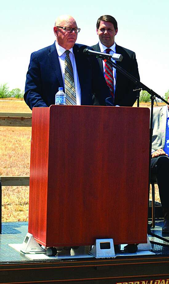 Congreeman Jody Jody Arrington listens as Economic Devvelopement Corporation executive director Mike Fox completes his introduction on Monday during a groundbreaking ceremony for the Plainview/Hale County Business Park. Photo: ROGER BLUHM/PLAINVIEW HERALD