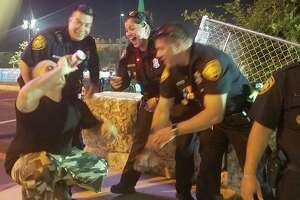 Facebook user Flawz Don Rodriguez snapped a picture of his friend Jose Garza chugging a beer while surrounded by laughing SAPD officers on Saturday.