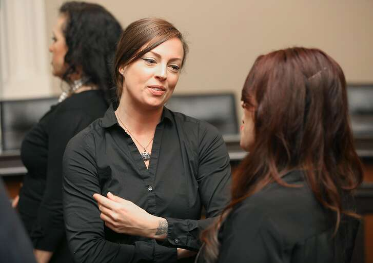 Victim of harassment Tara Zoumer (middle) speaks after a press conference at the State Capitol on Wednesday, April 18. 2018, in Sacramento, Calif.  Seeking to free sexual harassment victims from forced arbitration agreements that require maintained silence about what happened to them, the state Assembly is voting to subpoena victim to testify in open session.