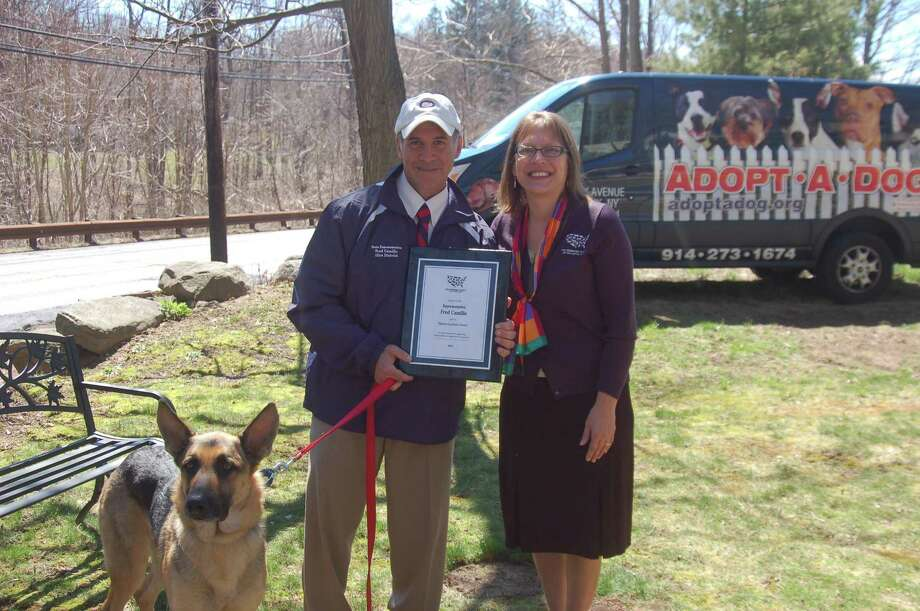 State Rep. Fred Camillo, R-Greenwich, is presented with the Humane Legislator Award by the Humane Society of the United States . Annie Hornish, the society's state director, gave Camillo, accompanied by his dog Teddy, the award. Photo: Ken Borsuk / Hearst Connecticut Media