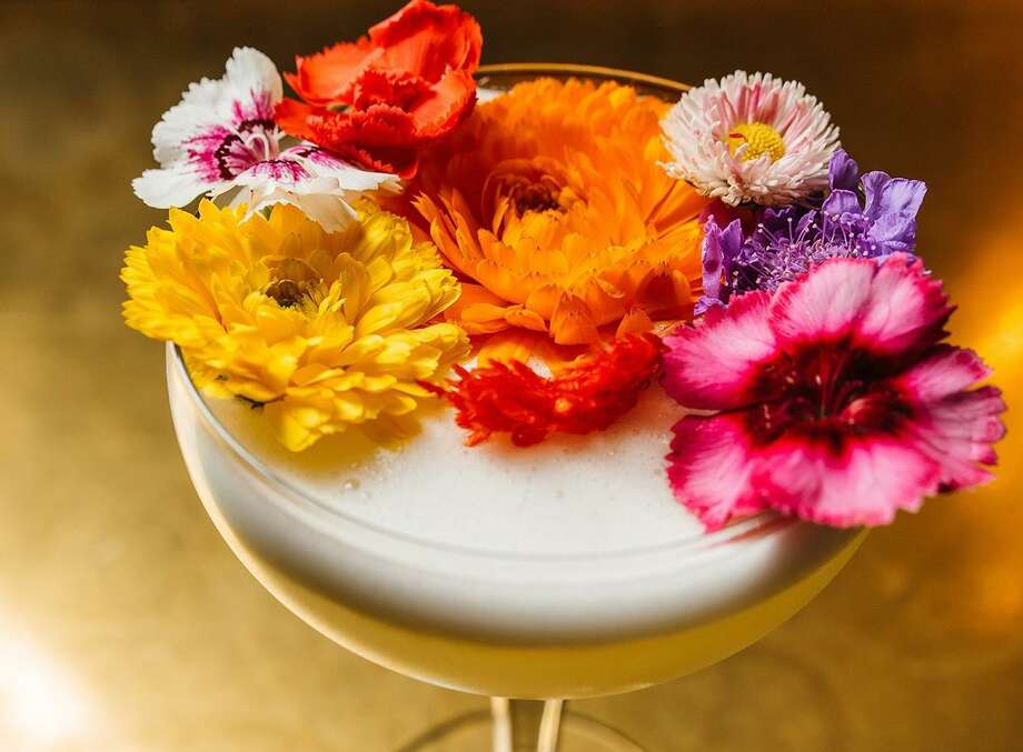 The Battle of Flowers is made with Uruapan Charanda (a take on Mexican rum), passion fruit, fresh lime juice and piloncillo sugar, topped with an arrangement of edible fresh flowers. It is available at Juniper Tar, 244 W. Houston St. Photo: Courtesy Josh Huskins / For Juniper Tar