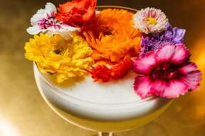 The Battle of Flowers is made with Uruapan Charanda (a take on Mexican rum), passion fruit, fresh lime juice and piloncillo sugar, topped with an arrangement of edible fresh flowers. It is available at Juniper Tar, 244 W. Houston St.