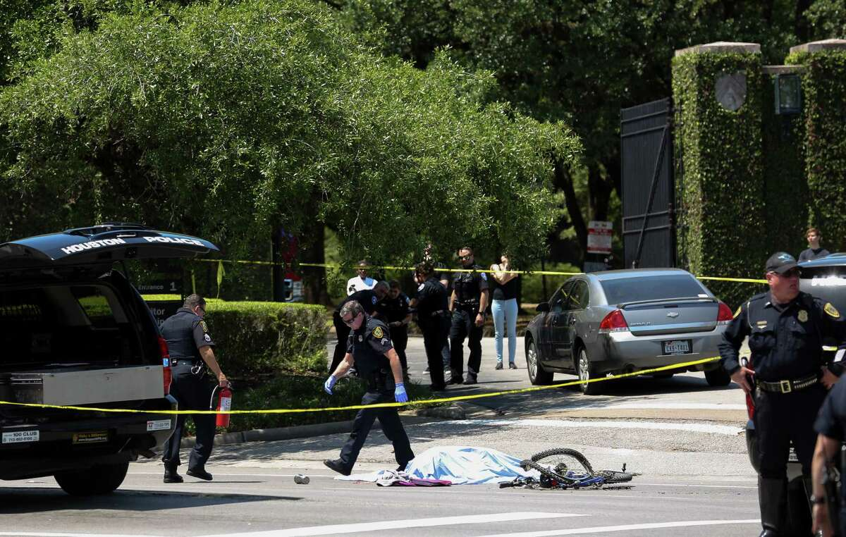HPD investigates the scene outside Rice University where a bicyclist was fatally struck at the intersection of South Main Street and Sunset Boulevard on Tuesday, April 24, 2018, in Houston.