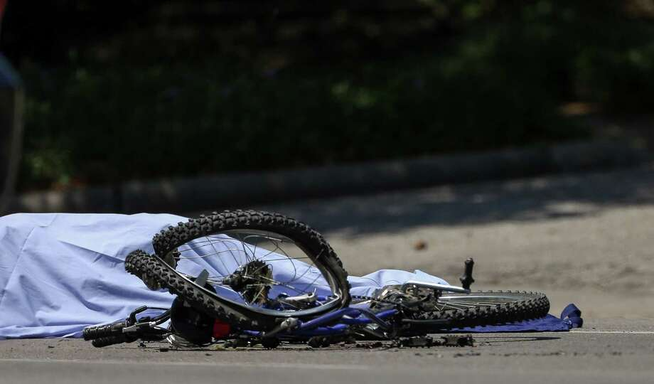 A bicyclist was fatally struck by a dump truck near Rice University. This was the third fatal crash in a month in Houston. Photo: Godofredo A. Vasquez, Houston Chronicle