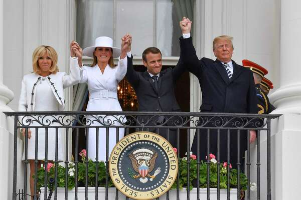 From right, President Trump, French President Emmanuel Macron, U.S. first lady Melania Trump and French first lady Brigitte Macron wave from the Truman Balcony of the White House on Tuesday during a state arrival ceremony.