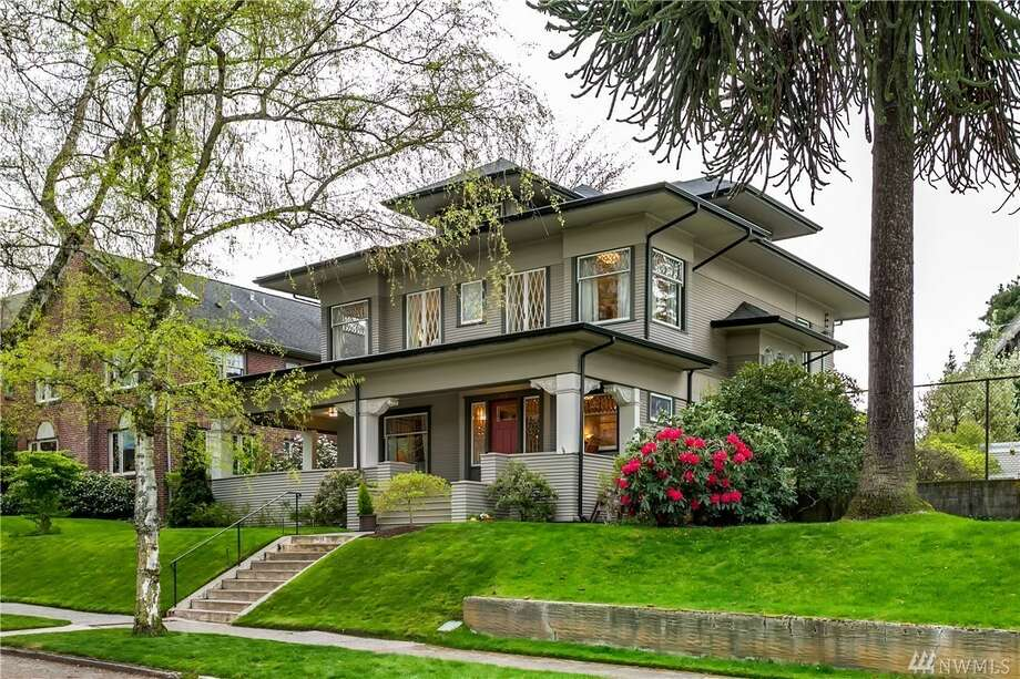"Stately and serene, this classic Seattle box is perched just above the street, and rocks beautiful crown moldings and gorgeous stained glass windows. Beyond that there's a ""gracious"" entry, as well as a generous living room with gas fireplace and large dining room.