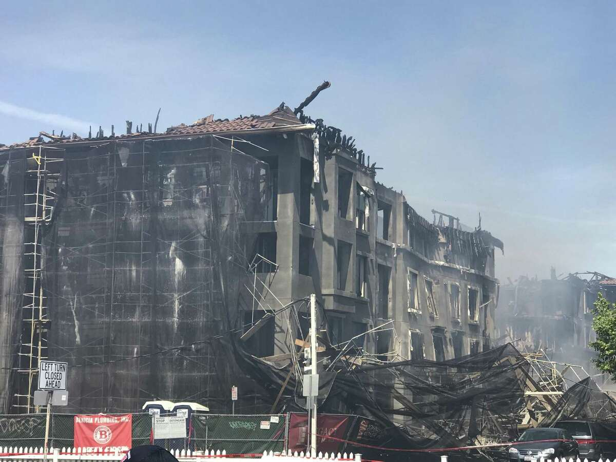 An early morning fire that decimated a five-story residential complex under construction in Concord last month - forcing the evacuation of 250 people from a neighboring residence - was started intentionally, federal authorities said Wednesday.