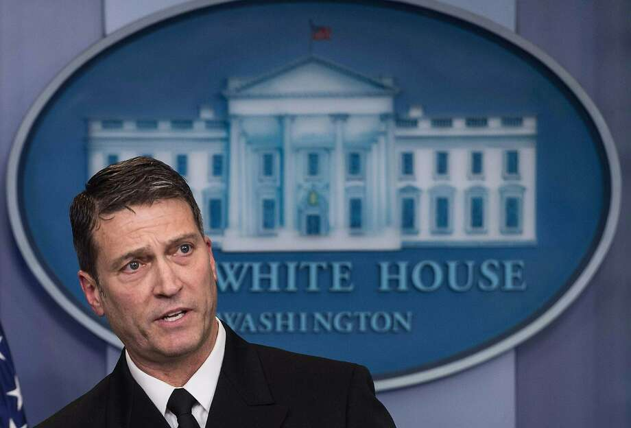 """(FILES) In this file photo taken on January 16, 2018 White House physician Rear Admiral Ronny Jackson speaks at the press briefing at the White House in Washington, DC. The US Senate on April 24, 2018 postponed a confirmation hearing for President Donald Trump's pick to lead the Department of Veterans Affairs, expressing concerns about """"serious allegations"""" facing the controversial nominee.The announcement threw the nomination of Rear Admiral Ronny Jackson, presently the White House doctor, into deep jeopardy as allegations surfaced that he oversubscribed medications while in the US Navy and at the White House, struggled with alcohol use, and created a hostile work environment.  / AFP PHOTO / NICHOLAS KAMMNICHOLAS KAMM/AFP/Getty Images Photo: NICHOLAS KAMM, AFP/Getty Images"""