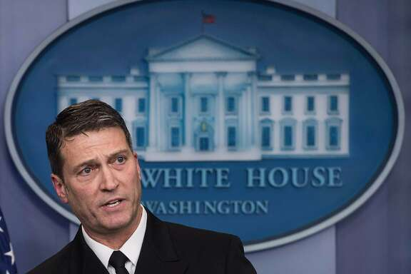 """(FILES) In this file photo taken on January 16, 2018 White House physician Rear Admiral Ronny Jackson speaks at the press briefing at the White House in Washington, DC. The US Senate on April 24, 2018 postponed a confirmation hearing for President Donald Trump's pick to lead the Department of Veterans Affairs, expressing concerns about """"serious allegations"""" facing the controversial nominee.The announcement threw the nomination of Rear Admiral Ronny Jackson, presently the White House doctor, into deep jeopardy as allegations surfaced that he oversubscribed medications while in the US Navy and at the White House, struggled with alcohol use, and created a hostile work environment.  / AFP PHOTO / NICHOLAS KAMMNICHOLAS KAMM/AFP/Getty Images"""