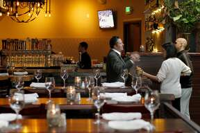 A long dining room precedes the square bar area with a bocce ball court on the side. Stock in Trade is a new restaurant opening in the high-profile Marina district of San Francisco, Calif. on Lombard Street.