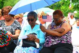 Tomball will host this year's National Day of Prayer at the Railroad Depot. Lorraine Brower, Shirley Thornton and Marna Johnson from the Anointed Faith Family Church prayed during the last year's event at The Depot in Tomball.