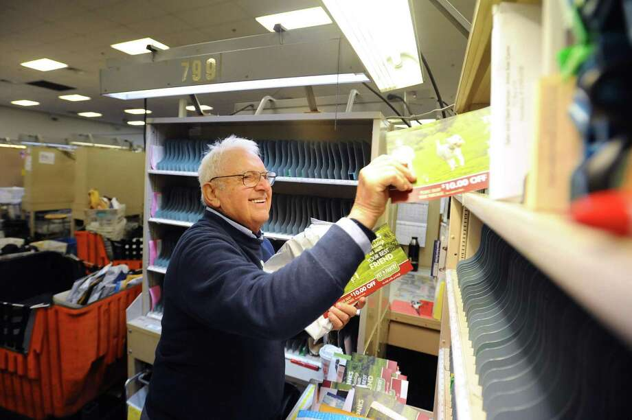 Tony Spadaccini, 81, sorts mail inside the Stamford Post Office on Camp Ave. before beginning his route through New Canaan in Stamford, Conn. on Tuesday, April 24, 2018. Spadaccini is celebrating his 60th year on the job. Photo: Michael Cummo / Hearst Connecticut Media / Stamford Advocate