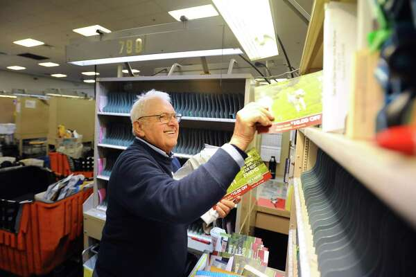 Tony Spadaccini, 81, sorts mail inside the Stamford Post Office on Camp Ave. before beginning his route through New Canaan in Stamford, Conn. on Tuesday, April 24, 2018. Spadaccini is celebrating his 60th year on the job.