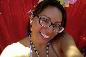 """Meet Marquita Richarte, also known as Alondra, also known as Kartel Azteca, also known as the """"Fiesta Sucia."""" She spoke candidly with mySA.com after becoming the subject of viral photos, videos and memes showing her dancing around Market Square's Fiesta celebration with a blue string bikini top on."""