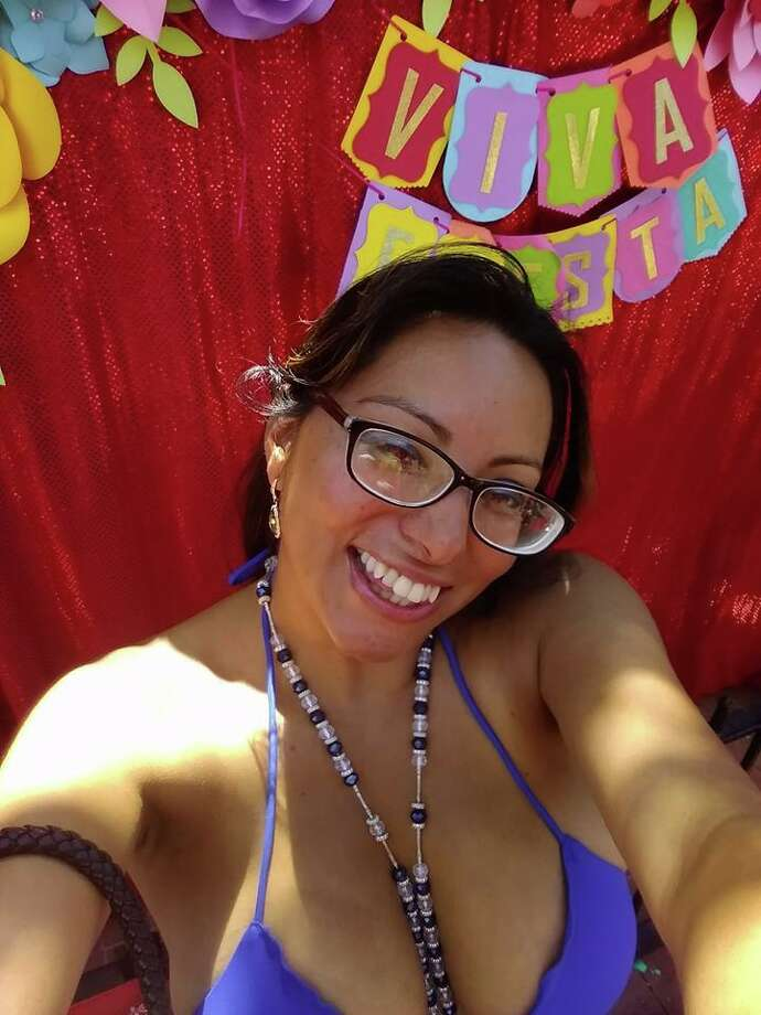 "Meet Marquita Richarte, also known as Alondra, also known as Kartel Azteca, also known as the ""Fiesta Sucia."" She spoke candidly with mySA.com after becoming the subject of viral photos, videos and memes showing her dancing around Market Square's Fiesta celebration with a blue string bikini top on. Photo: Courtesy, Marquita Richarte"