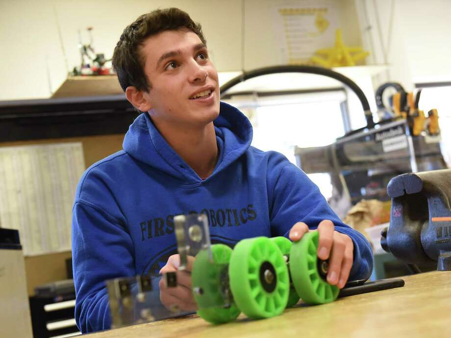 Albany High School junior Noah Greenblatt tinkers with a robot part in the shop class on Monday, April 23, 2018, in Albany, N.Y. Greenblatt and the rest of the Albany High School robotics team won the regional robotics championship and is going to the national competition in Detroit on Wednesday. (Lori Van Buren/Times Union) Photo: Lori Van Buren, Albany Times Union / 40043572A