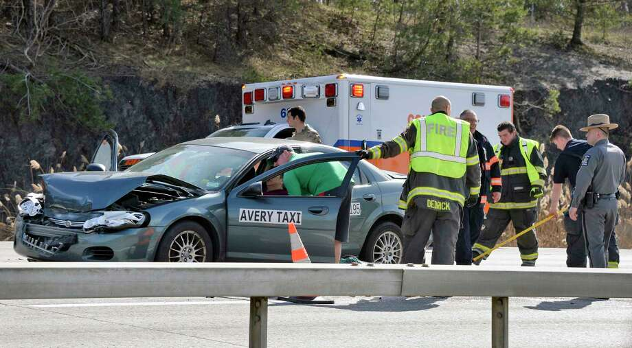 Emergency personal respond to an Avery Taxi involved in an accident in the east bound lanes of Alternate Route 7 Tuesday afternoon April 24, 2018 in Colonie, NY.  (John Carl D'Annibale/Times Union) Photo: John Carl D'Annibale, Albany Times Union