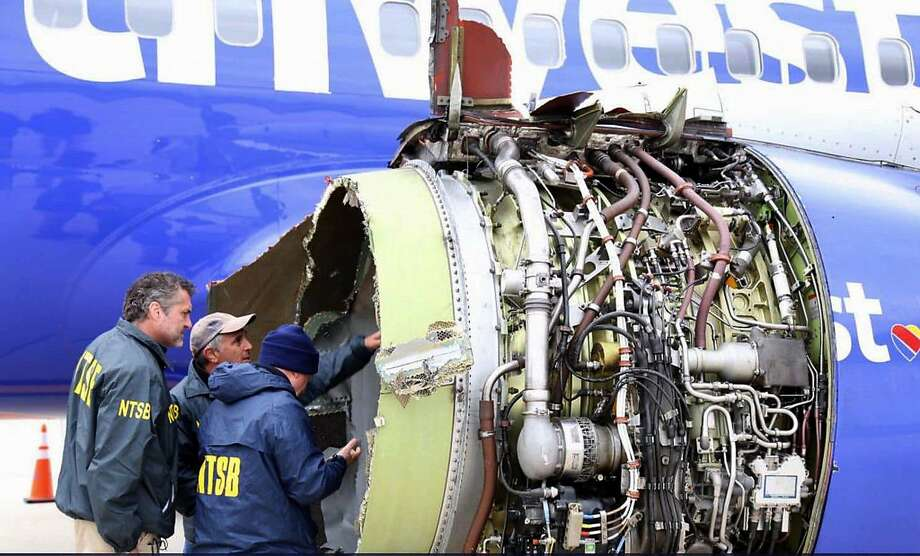 National Transportation Safety Board investigators inspect the Southwest Airlines engine that exploded in flight April 17. Photo: National Transportation Safety Board