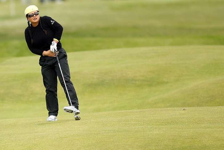 Christina Kim of the U.S. follows a shot on the sixth hole during the third round of the Women's British Open Golf Championship at Royal Lytham St Annes Golf Course, Lytham St Annes, England, Saturday, Aug. 1, 2009. (AP Photo/Peter Morrison)