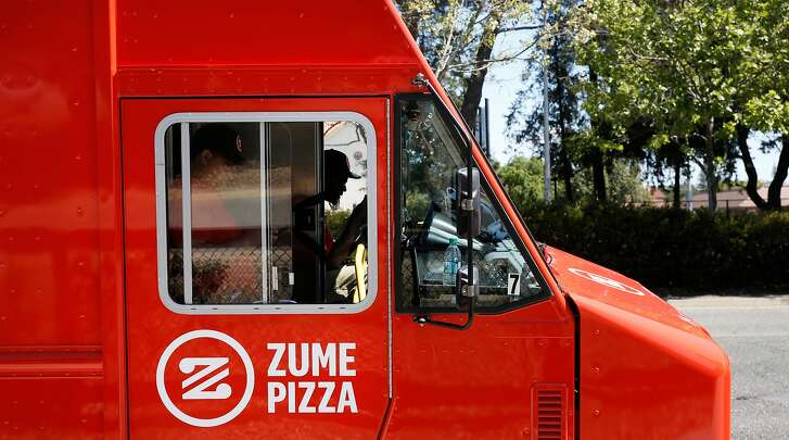 "Skylar Morris, in the driver's seat is the Captain ""Pielot"" of this crew which is parked along El Camino Real in Palo Alto, Calif.  on Tues. April 17, 2018. Zume Pizza uses robotic pizza-makers and smart ovens inside a truck to deliver cooked-to-order pizzas to customers."