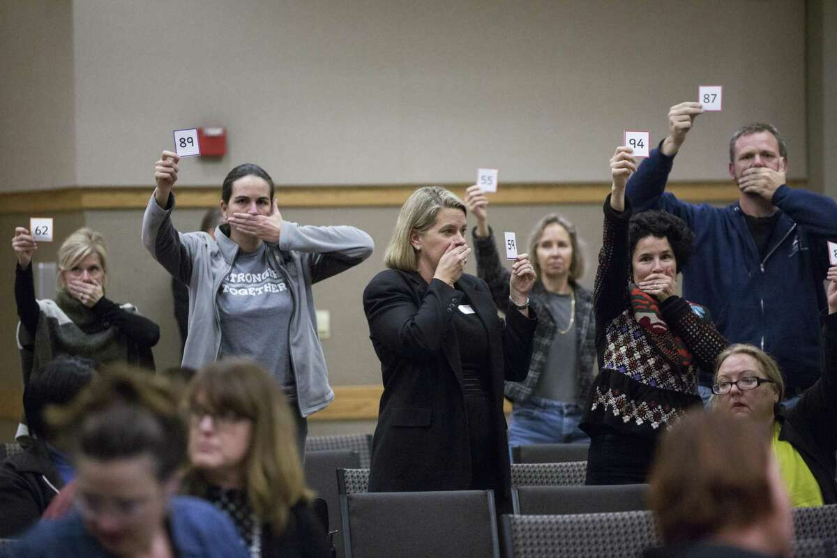 About 50 minutes before midnight, parents pressure the panel of representatives from the U.S. Department of Education's Office of Special Education and Rehabilitative Services (OSERS) and the Texas Education Agency (TEA) to extend a hearing about special education, Thursday, Dec. 15, 2016, in Austin.