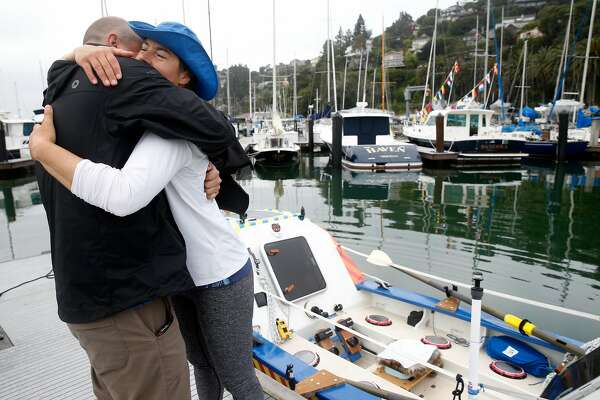 Lia Ditton hugs friend and supporter Ewan O�Leary before launching her 21-foot boat from the San Francisco Yacht Club in Belvedere, Calif. in an attempt to row around the Farallon Islands on Tuesday, April 24, 2018. Ditton is hoping to be the first solo rower to circle the Farallones and return in two days.