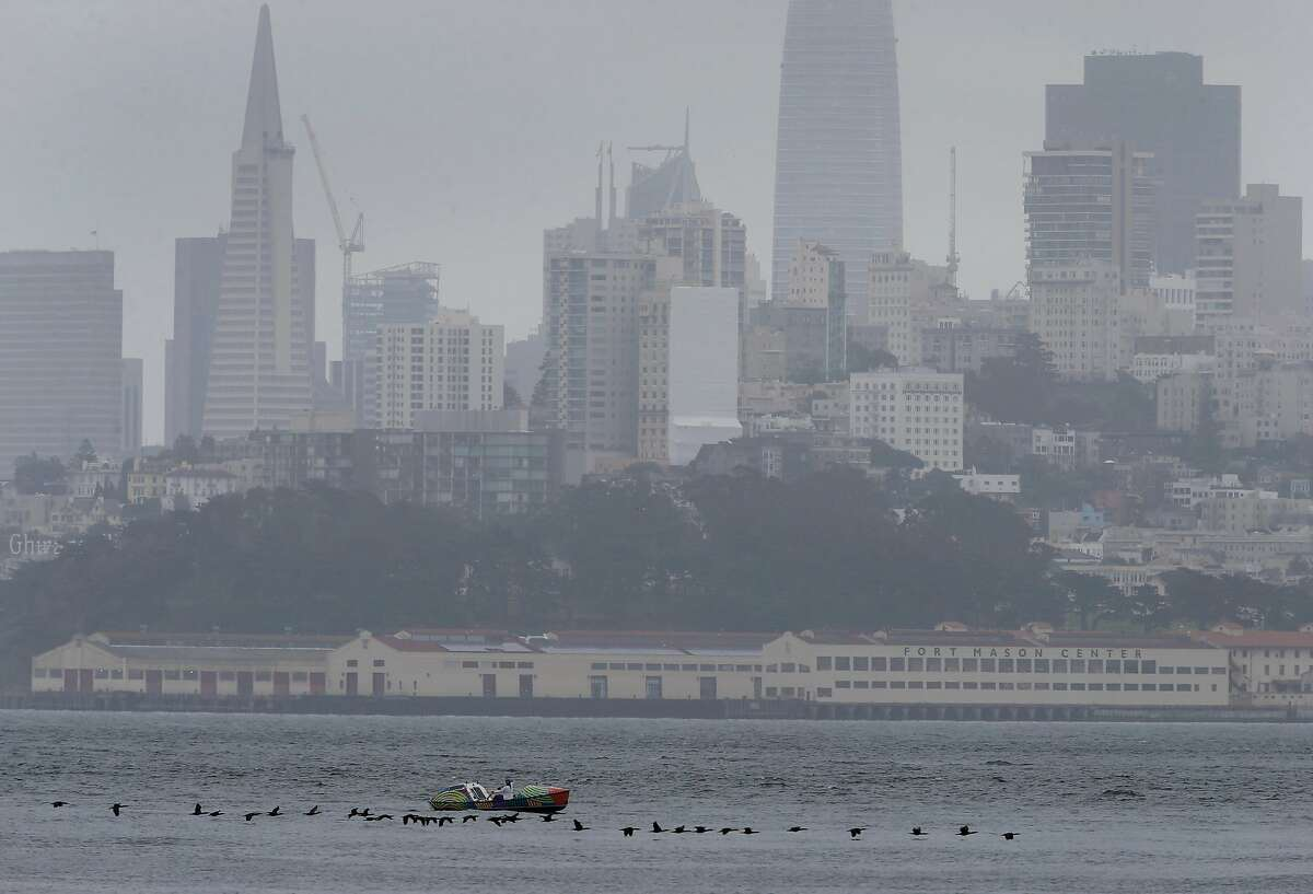 Lia Ditton rows her 21-foot boat on the bay towards the Golden Gate Bridge in San Francisco.