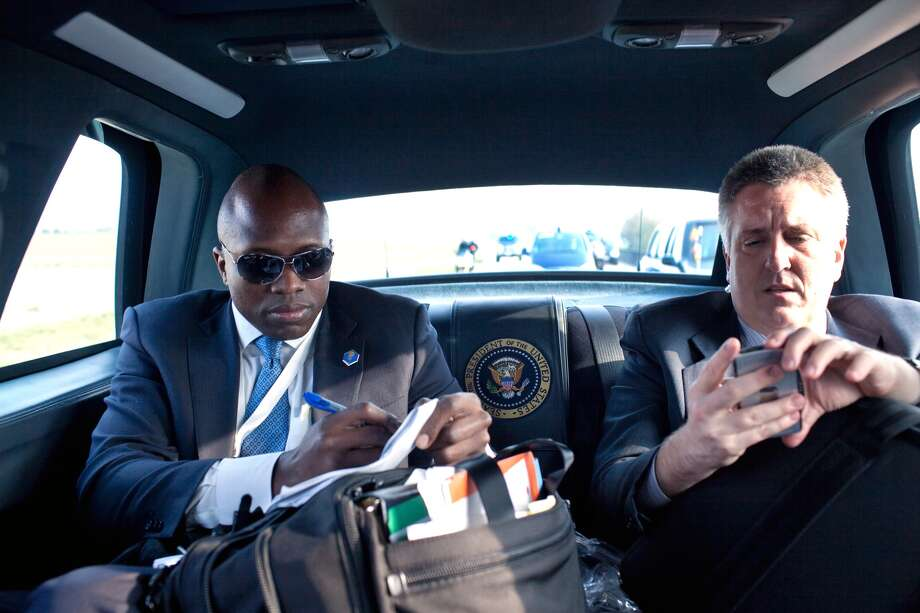 FILE — President Barack Obama's personal aide Reggie Love, left,  and White House physician Dr. Jeffrey Kuhlman check their notes as they travel in the Presidential motorcade April 4, 2009 in Strasbourg, France. Photo: Pete Souza/White House