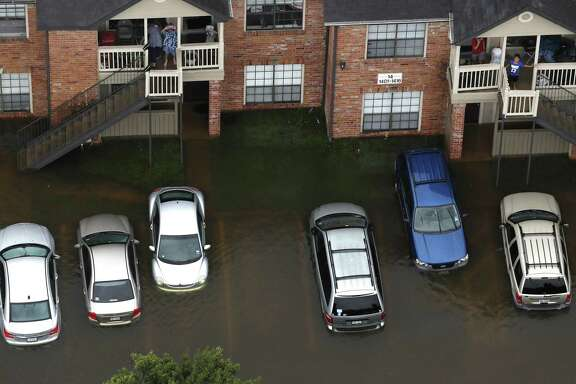 Floodwaters from Tropical Storm Harvey surround an apartment complex on Tuesday, Aug. 29, 2017, in Houston. ( Brett Coomer / Houston Chronicle )