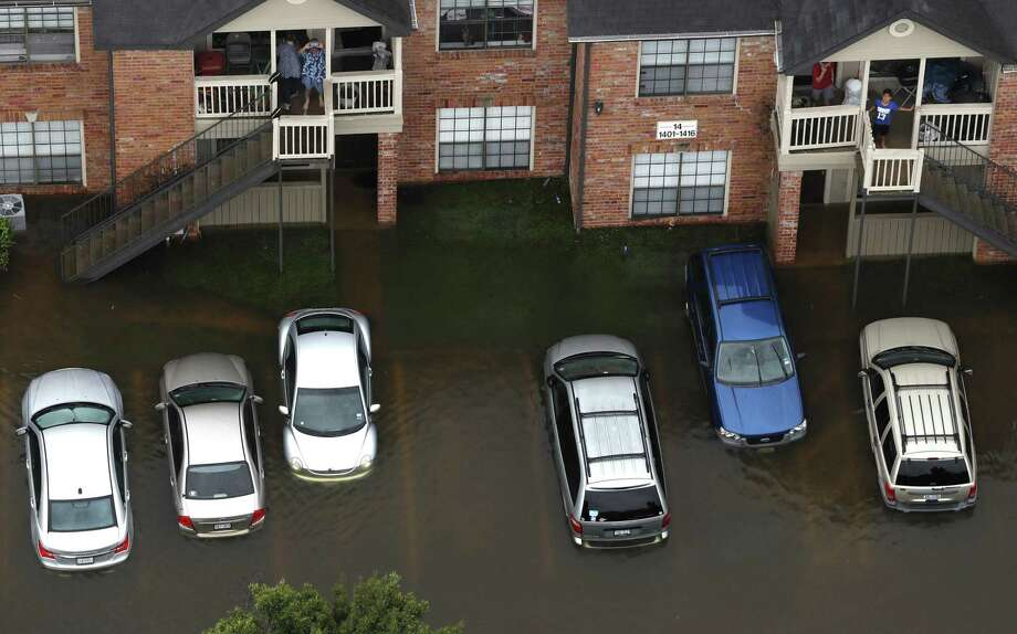 Floodwaters from Tropical Storm Harvey surround an apartment complex on Tuesday, Aug. 29, 2017, in Houston. ( Brett Coomer / Houston Chronicle ) Photo: Brett Coomer, Staff / Houston Chronicle / © 2017 Houston Chronicle