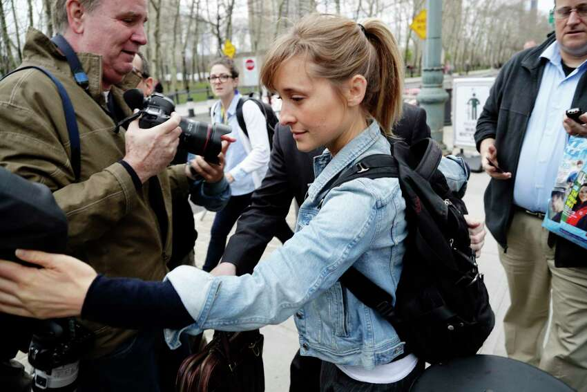 Allison Mack leaves Federal court Tuesday, April 24, 2018, in the Brooklyn borough of New York. Federal prosecutors say the television actress best known for playing a young Superman's close friend has been charged with sex trafficking for helping recruit women to be slaves of a man who sold himself as a self-improvement guru.