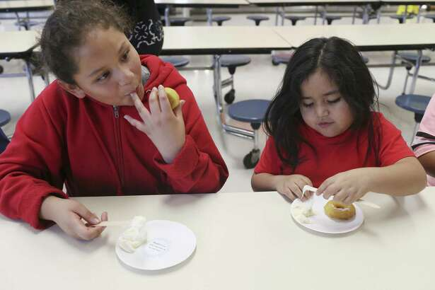 A fourth-grader enjoys donuts from a pre-K student at Kindred Elementary School before the STAAR)test. A reader thinks this strategy was inappropriate.
