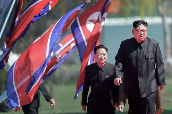 Leader Kim Jong Un (right, with Choe Ryong Hae, a vice chairman for the Workers' Party) says North Korea will stop nuclear and intercontinental ballistic missile tests. However, it did not indicate it will give up its nuclear arsenal or halt its production of missiles.