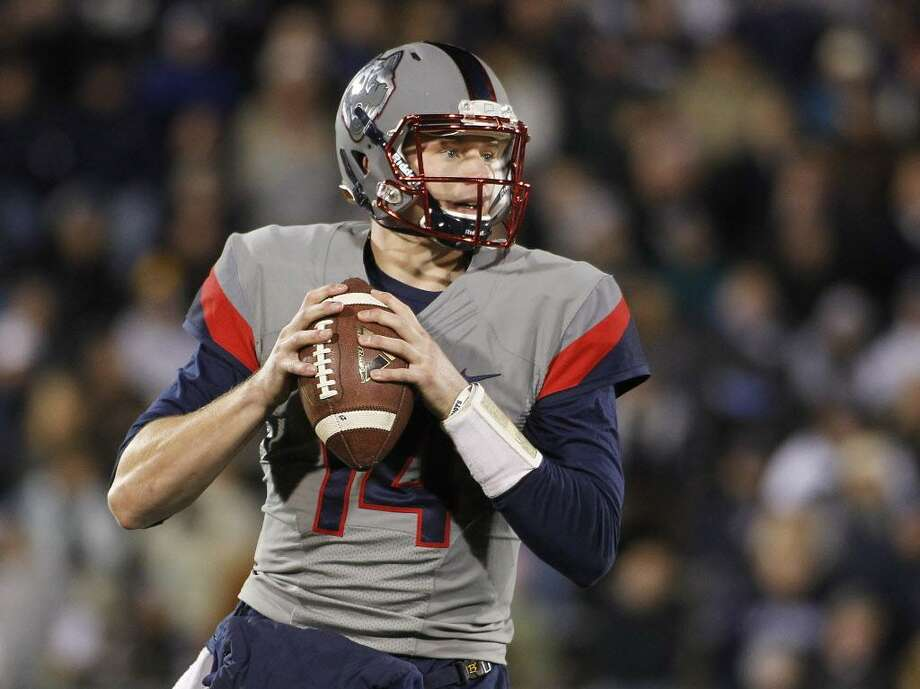 UConn quarterback Tim Boyle drops back to pass during a game against Houston on Nov. 21, 2015, in East Hartford. Photo: Stew Milne / Associated Press / FR56276 AP