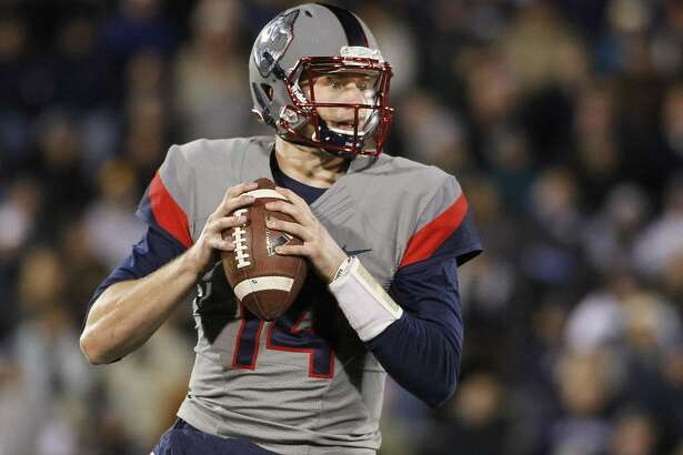 UConn quarterback Tim Boyle drops back to pass during a game against Houston on Nov. 21, 2015, in East Hartford.