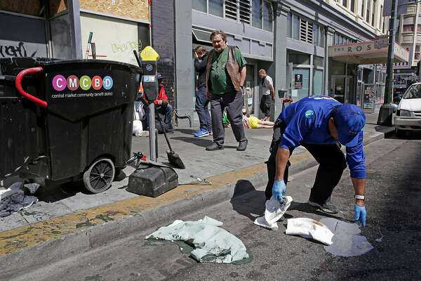 A Community Guide, (declined to give his name) cleans along 6th st. between Mission and Howard streets on Mon. April 23, 2018, in San Francisco, Calif. San Francisco City Hall politicians continue to struggle with a fix for the real public health menace on our sidewalks the dirty needles, tent encampments, feces and foul garbage.
