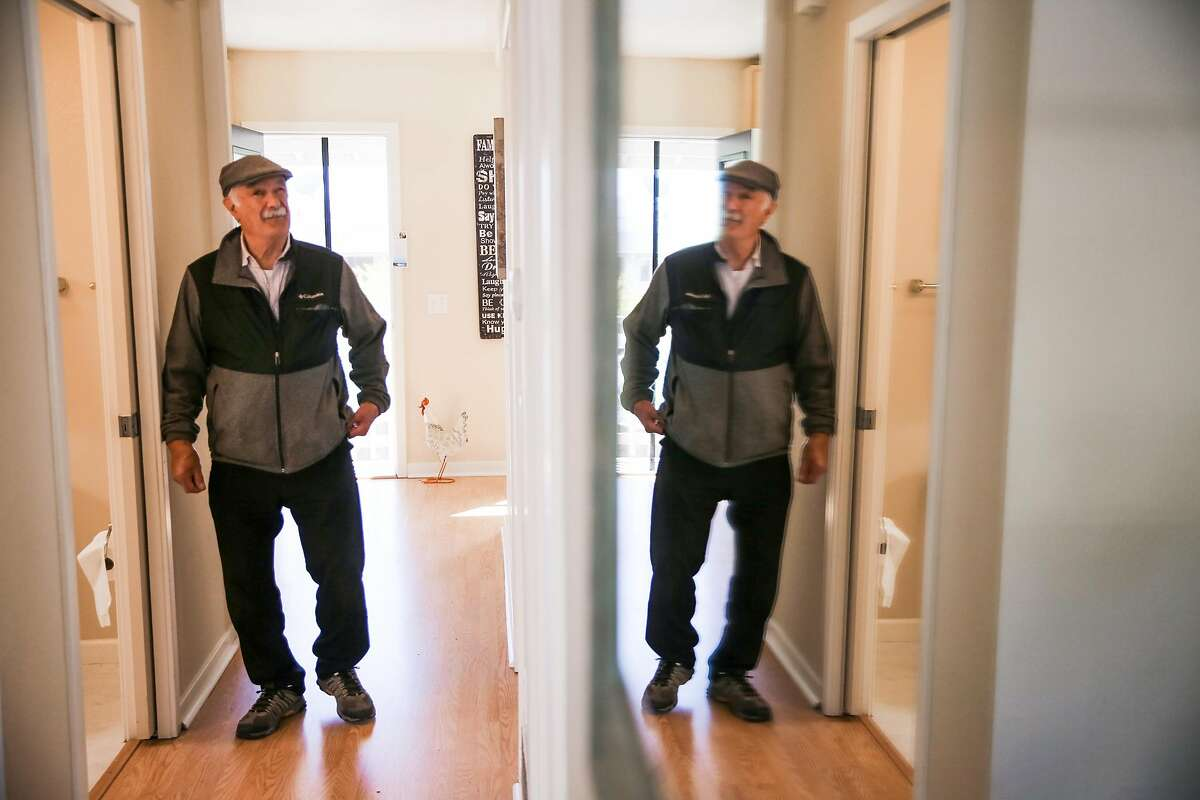 Joe Stangelini checks out a house for a friend during an open house on 2nd Lane in South San Francisco, California, on Sunday, April 22, 2018.