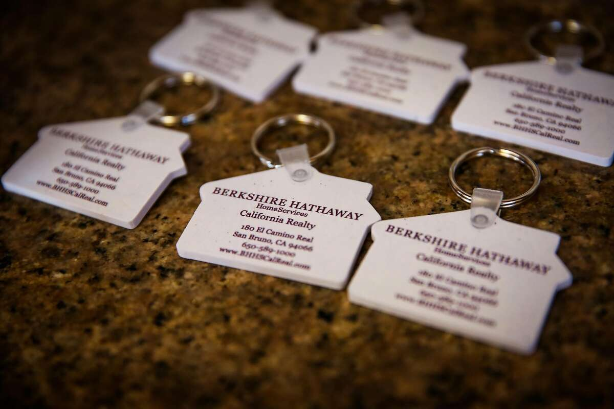 Keychains with the real estate agent information is seen at an open house on 2nd Lane in South San Francisco, California, on Sunday, April 22, 2018.