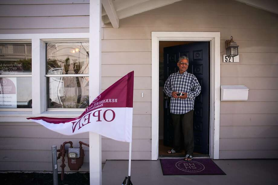 Ashok Patel stands in the doorway of a home for sale on Second Lane in South San Francisco during an open house last weekend. Chronic under-supply of homes in the Bay Area has helped keep prices high. Photo: Gabrielle Lurie / The Chronicle